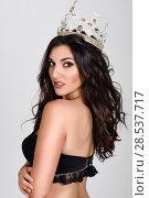 Купить «Crowned woman like miss of beauty looking at camera isolated on white background. Girl wearing crown, studio shot.», фото № 28537717, снято 30 мая 2017 г. (c) Ingram Publishing / Фотобанк Лори