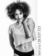 Купить «Young black woman with afro hairstyle. Girl wearing t-shirt and black panties. Studio shot.», фото № 28537721, снято 14 июня 2016 г. (c) Ingram Publishing / Фотобанк Лори