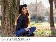 Купить «Portrait of thoughtful woman sitting alone outdoors wearing hat. Nice backlit with sunlight», фото № 28538577, снято 12 января 2016 г. (c) Ingram Publishing / Фотобанк Лори