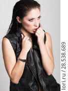 Купить «Brunette woman with blue eyes wearing black leather jacket and panties on white background. Studio shoot», фото № 28538689, снято 25 ноября 2014 г. (c) Ingram Publishing / Фотобанк Лори