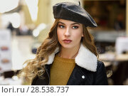 Купить «Blonde russian woman in urban background. Beautiful young girl wearing beret, black leather jacket and mini skirt standing in the street. Pretty female with long wavy hair hairstyle and blue eyes.», фото № 28538737, снято 24 января 2017 г. (c) Ingram Publishing / Фотобанк Лори