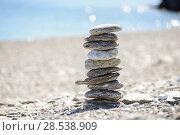 Купить «Pebbles in balancing on the sea coast», фото № 28538909, снято 22 февраля 2014 г. (c) Ingram Publishing / Фотобанк Лори