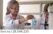 Купить «teacher and students studying chemistry at school», видеоролик № 28544233, снято 28 мая 2018 г. (c) Syda Productions / Фотобанк Лори