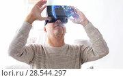 Купить «senior man in vr headset with earth projection», видеоролик № 28544297, снято 22 мая 2019 г. (c) Syda Productions / Фотобанк Лори