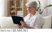 Купить «happy senior woman with tablet pc at home», видеоролик № 28544361, снято 30 мая 2018 г. (c) Syda Productions / Фотобанк Лори