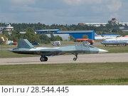 Купить «Российский многоцелевого истребителя пятого поколения Су-57( ПАК ФА, Т-50), Международный авиационно-космический салон МАКС-2015», фото № 28544445, снято 23 августа 2015 г. (c) Малышев Андрей / Фотобанк Лори
