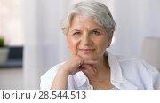 Купить «portrait of happy senior woman», видеоролик № 28544513, снято 29 мая 2018 г. (c) Syda Productions / Фотобанк Лори