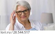 Купить «portrait of happy senior woman in glasses», видеоролик № 28544517, снято 29 мая 2018 г. (c) Syda Productions / Фотобанк Лори