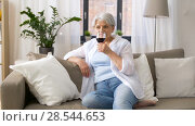 Купить «senior woman drinking red wine from glass at home», видеоролик № 28544653, снято 30 мая 2018 г. (c) Syda Productions / Фотобанк Лори