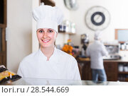 Купить «Bakery female worker with delicious pies and rolls on counter», фото № 28544669, снято 22 апреля 2017 г. (c) Яков Филимонов / Фотобанк Лори