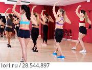 Купить «Active females dancing excited posing», фото № 28544897, снято 31 мая 2017 г. (c) Яков Филимонов / Фотобанк Лори