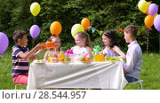 Купить «kids giving presents to birthday child at party», видеоролик № 28544957, снято 5 июня 2018 г. (c) Syda Productions / Фотобанк Лори
