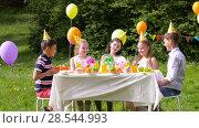 Купить «happy kids with gifts on birthday party at summer», видеоролик № 28544993, снято 5 июня 2018 г. (c) Syda Productions / Фотобанк Лори