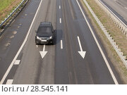 Купить «Car modern black on the  highway», фото № 28545141, снято 12 июля 2015 г. (c) Юрий Бизгаймер / Фотобанк Лори