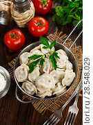 Купить «Dumplings in the pot», фото № 28548029, снято 21 февраля 2018 г. (c) Надежда Мишкова / Фотобанк Лори