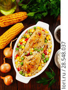 Купить «Chicken legs baked with rice and vegetables», фото № 28548037, снято 6 марта 2018 г. (c) Надежда Мишкова / Фотобанк Лори