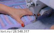 Купить «Tailor sewing fur coat with sewing machine», видеоролик № 28548317, снято 12 апреля 2018 г. (c) Aleksey Popov / Фотобанк Лори