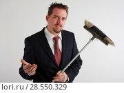 Купить «Young business man with dusty broom», фото № 28550329, снято 27 мая 2020 г. (c) age Fotostock / Фотобанк Лори