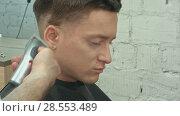 Купить «Close up portrait of young handsome man with perfect skin and hair. Cutting hairs.», видеоролик № 28553489, снято 20 июня 2016 г. (c) Vasily Alexandrovich Gronskiy / Фотобанк Лори