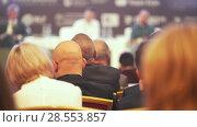 Купить «Many people sitting in the large hall at business conference», видеоролик № 28553857, снято 25 июня 2018 г. (c) Константин Шишкин / Фотобанк Лори