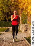 Купить «Fit Woman Doing Cardio Exercises In The Park», фото № 28555245, снято 21 ноября 2017 г. (c) Pavel Biryukov / Фотобанк Лори