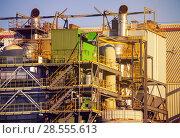 Купить «Industrial view of oil refinery plant at day time», фото № 28555613, снято 14 июля 2017 г. (c) Сергей Новиков / Фотобанк Лори