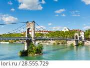 Купить «Gateway College walking bridge over Rhone river», фото № 28555729, снято 14 июля 2017 г. (c) Сергей Новиков / Фотобанк Лори