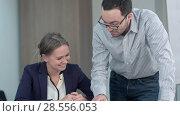 Купить «Two teachers are talking in the school hall to their next lesson together», фото № 28556053, снято 6 июня 2020 г. (c) Vasily Alexandrovich Gronskiy / Фотобанк Лори