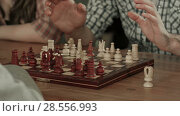 Купить «Two men play chess», видеоролик № 28556993, снято 6 июня 2017 г. (c) Vasily Alexandrovich Gronskiy / Фотобанк Лори
