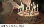 Купить «Two people lighting the candels on a birthday cake», видеоролик № 28557013, снято 7 июня 2017 г. (c) Vasily Alexandrovich Gronskiy / Фотобанк Лори