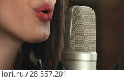 Купить «Female singer and microphone», видеоролик № 28557201, снято 7 июня 2017 г. (c) Vasily Alexandrovich Gronskiy / Фотобанк Лори