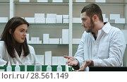 Купить «Two adult pharmacists having conflict, discussing problems at pharmacy», фото № 28561149, снято 21 февраля 2019 г. (c) Vasily Alexandrovich Gronskiy / Фотобанк Лори