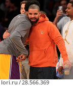 Купить «Drake sits court-side at the Los Angeles Lakers vs the Golden State Warriors game at the Staples Center Featuring: Drake Where: Los Angeles, California...», фото № 28566369, снято 4 ноября 2016 г. (c) age Fotostock / Фотобанк Лори