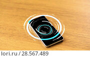 Купить «smartphone with virtual circuit hologram on table», видеоролик № 28567489, снято 20 октября 2019 г. (c) Syda Productions / Фотобанк Лори