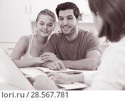 Купить «Loving couple with female designer at home», фото № 28567781, снято 22 сентября 2019 г. (c) Яков Филимонов / Фотобанк Лори