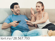 Купить «Couple arguing because of TV remote», фото № 28567793, снято 22 марта 2019 г. (c) Яков Филимонов / Фотобанк Лори