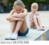 Купить «Small sisters upset after quarrel outside», фото № 28576945, снято 20 июля 2017 г. (c) Яков Филимонов / Фотобанк Лори