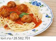 Купить «Фрикадельки со спагетти в томатном соусе», фото № 28582701, снято 28 мая 2018 г. (c) Dmitry29 / Фотобанк Лори