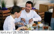 Купить «Happy business people on their lunch outside at the coffee shop», фото № 28585385, снято 29 марта 2020 г. (c) Vasily Alexandrovich Gronskiy / Фотобанк Лори