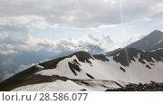 Купить «Panorama of Caucasian mountains from Rosa Khutor resort In the rain in Russia», видеоролик № 28586077, снято 15 июня 2018 г. (c) Володина Ольга / Фотобанк Лори