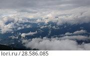 Купить «Panorama of Caucasian mountains from Rosa Khutor resort in Russia», видеоролик № 28586085, снято 15 июня 2018 г. (c) Володина Ольга / Фотобанк Лори