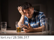 Купить «man with cellphone drinking alcohol and smoking», фото № 28586317, снято 24 ноября 2017 г. (c) Syda Productions / Фотобанк Лори