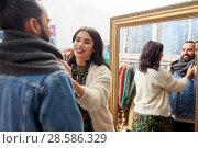 Купить «couple choosing clothes at vintage clothing store», фото № 28586329, снято 30 ноября 2017 г. (c) Syda Productions / Фотобанк Лори