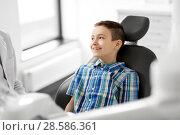 happy smiling kid patient at dental clinic. Стоковое фото, фотограф Syda Productions / Фотобанк Лори