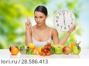 Купить «woman with food and clock showing six», фото № 28586413, снято 12 января 2013 г. (c) Syda Productions / Фотобанк Лори