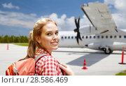 Купить «tourist woman with backpack traveling by plane», фото № 28586469, снято 25 июля 2015 г. (c) Syda Productions / Фотобанк Лори