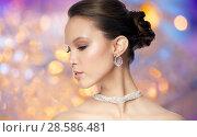 Купить «close up of beautiful woman face with earring», фото № 28586481, снято 9 апреля 2016 г. (c) Syda Productions / Фотобанк Лори