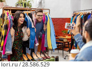 Купить «happy couple having fun at vintage clothing store», фото № 28586529, снято 30 ноября 2017 г. (c) Syda Productions / Фотобанк Лори