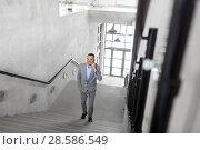 Купить «businessman calling on smartphone at office», фото № 28586549, снято 25 февраля 2018 г. (c) Syda Productions / Фотобанк Лори