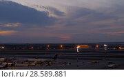 Купить «Evening view of planes at Terminal D in Sheremetyevo Airport, Moscow», видеоролик № 28589881, снято 11 сентября 2017 г. (c) Данил Руденко / Фотобанк Лори